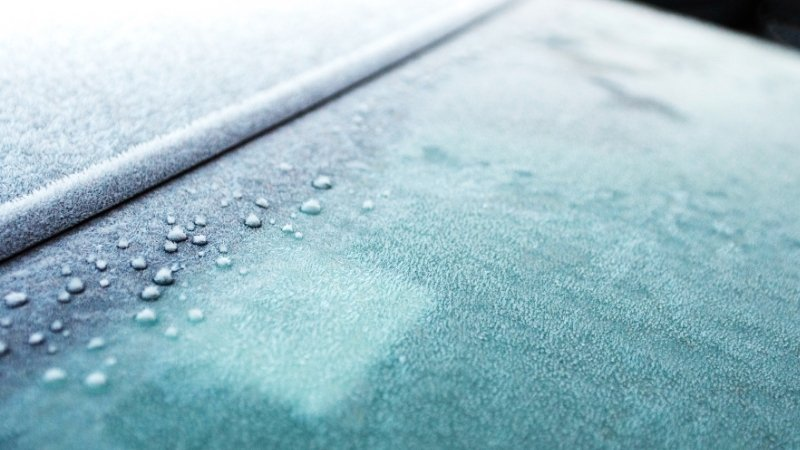 Use a towel on a car windscreen to avoid freezing