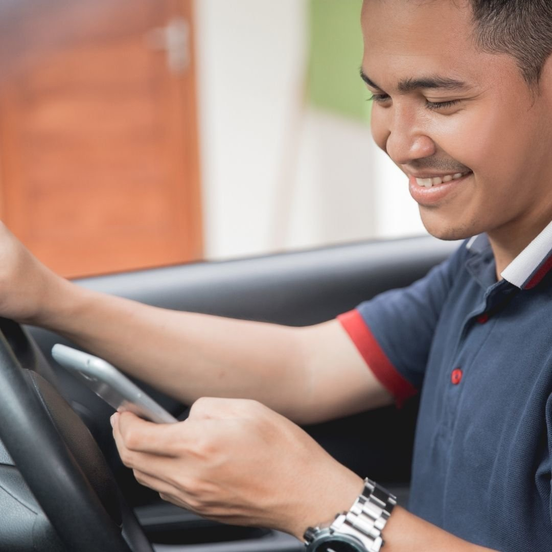 Man on Phone While Driving