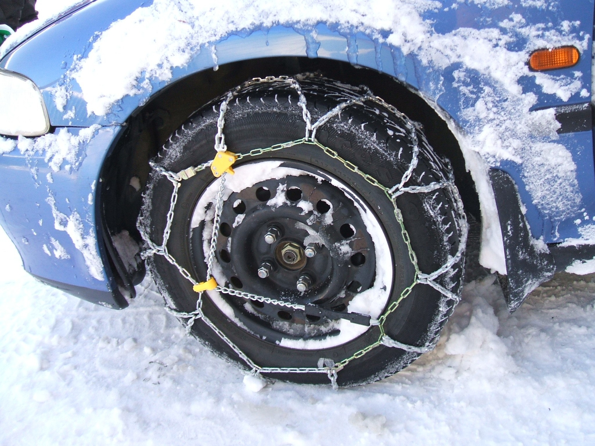 snow chains on a car